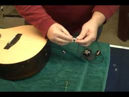 installing an end pin jack in an acoustic guitar installing an end pin jack in an acoustic guitar