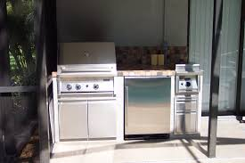 it has a double grill storage for the tanks a refrigerator with an icemaker storage drawers and a side burner this was completed in just three days