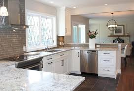 view in gallery white ice granite in a kitchen with grey tile