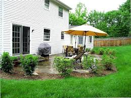 creating privacy with landscaping planting shrubs around your patio is a good way to landscape and
