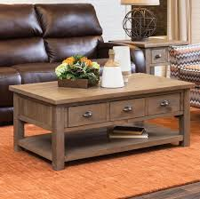 This print raises the coffee table up enough. Slater Mill Cocktail Table Schneiderman S Furniture