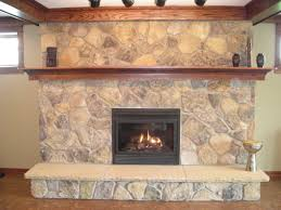 great wooden floating shelves with wooden burning fireplace hearth