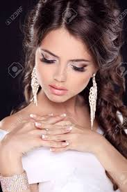 beautiful young bride portrait in white dress fashion beauty make up jewelry