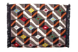 the ubuhle besintu rug is hand woven with hand spun yarn is fully reversable and suitable for indoor residential or commercial use