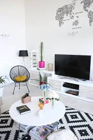 we love the creative use of an artistic black and white map in this globally inspired living room