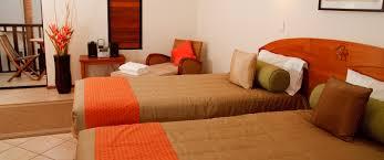 Orange And Brown Bedroom Two Bed Apartment Port Douglas Hibiscus Resort