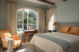 dazzling swing arm curtain rod in bedroom terranean with light blue walls next to bedroom color idea