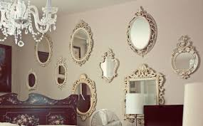 glamorous multiple decorative wall mirrors with ivory colored ornate and chandelier