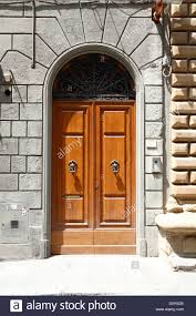 Typical wooden Frontdoor in Florence, Tuscany, Italy Stock Photo ...