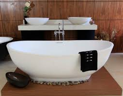 bathroom fascinating white porcelain freestanding soaking bathtub with some small natural stone as the accessories