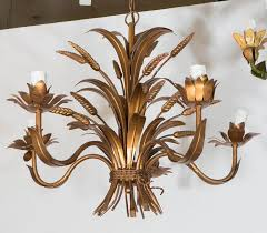 a vintage hollywood regency style five arm chandelier produced in france circa 1960s