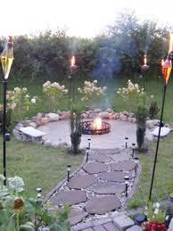 garden lighting design ideas. Astounding Backyard Decoration By Building Fire Pit : Astonishing Design Ideas Using Black Iron Post Garden Lighting