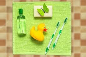 bathroom interior bathroom bath tub toy child care children yellow green green background bottle wash toothbrush brush bath accessories bath