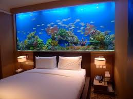 Attractive Marvelous Fish Tank Bedroom Wall Design With Small Table Lamp Images