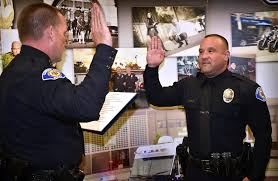 garden grove police chief todd elgin left swears in chris doveas as ggpd s newest reserve officer photo by steven georges behind the badge oc