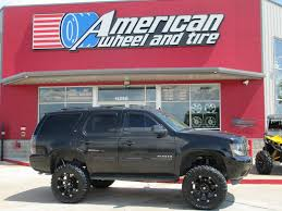 Ballistic 814 Jester Wheels in Flat Black on a lifted Chevrolet ...
