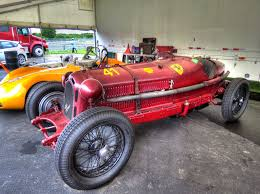 italian race cars. most italian racing cars through the early 1960s used a center gas pedal, designed to facilitate heal-and-toe downshifts while braking. race o