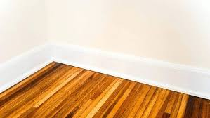 trim your home common wood molding types white baseboard on refinished hardwood floors flooring of