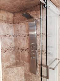 Custom Charlotte shower with frameless glass door and decorative tilejpg
