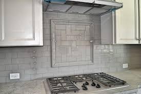 white and gray tile backsplash