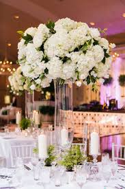 tall hydrangea centerpieces. Wonderful Centerpieces Clear Glass Riser With White Arrangement Of Hydrangea Flowers Rose Tulip  And Green Leaves Throughout Tall Hydrangea Centerpieces