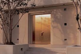 metal doors. Fused Metal Doors In Bronze With Sandstone Finish And Circle Impression
