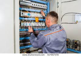 electrical installation stock images, royalty free images Fuse Box Circuit Builder electrician testing industrial machine, electrician builder engineer screwing equipment in fuse box, male electrician the fuse box circuit builder