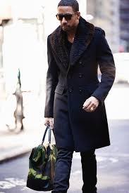 men s black fur collar coat black crew neck sweater navy jeans dark green camouflage canvas tote bag men s fashion