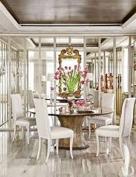 in the dining room a gracie wallpaper was used on the ceiling and mirrored panels conceal storage for tableware solís betancourt sherrill designed the