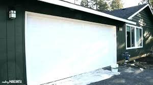 painting a garage door roller or brush roller