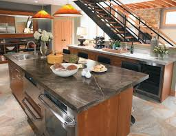 trendy kitchen with stainless steel appliances a drop in sink flat panel cabinets formica