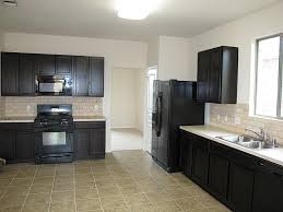full size of cabinets espresso with white appliances limestone countertops kitchen black lighting flooring sink faucet