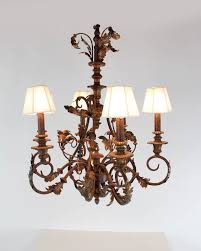 arms and acanthus leaf motif the column is an urn and finial style candle style lighting at the end of each arm topped with silk string hexagonal