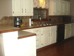 Brown And White Kitchens Brown Kitchen Cabinets With White Backsplash Quicuacom