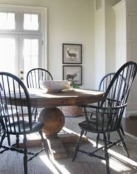 black windsor chairs with distressed pedestal table for eat in