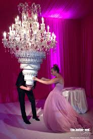 kaley cuoco has upside down wedding cake suspended from chandelier by the er end cakery