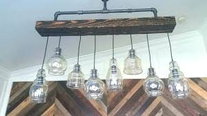 wood beam chandelier chandeliers details industrial steel pipe and rustic barn how canada r
