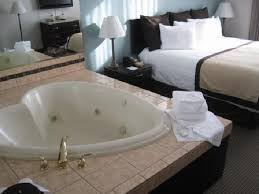 quality inn suites heart shaped jacuzzi next to king bed