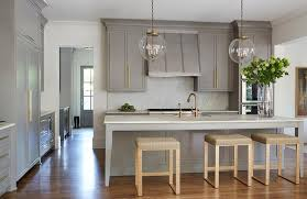black cabinet pulls on gray cabinets. gray kitchen island with gold counter stools black cabinet pulls on cabinets