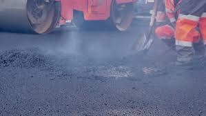 Road Workers Laid Asphalt Repairing The Road In The Historic Center Of A European City Stock Footage