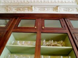 The Inside Of CliqStudios Fairmont Kitchen Cabinets In Cherry.