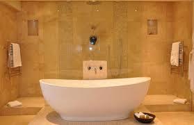 bathtub design bathroom oval white acrylic bathtub on ceramics flooring combined by towel with chrome hook