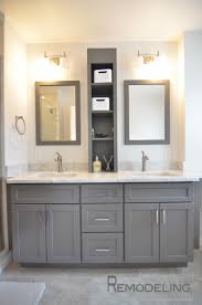 bathroom lighting over vanity. double wall mounted rectangle mirror frames over gray vanity and white marble top as well light fixtures in small space bathroom designs lighting