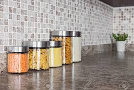 kitchen counter with food. Food Ingredients In Glass Jars On A Kitchen Counter Top. Stock Photo - 17677400 With