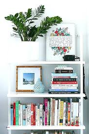 hang art without nails bookshelf hanging framed how to up canvas ar