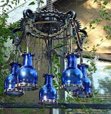 picture of outdoor chandelier lighting made with trash and krylon paint