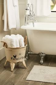 trisha yearwood new home decor collection from tractor supply galvanized bucket to hold towels in bathroom