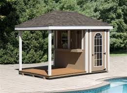 Here's a small pool house that sits right beside the edge of the swimming  pool.