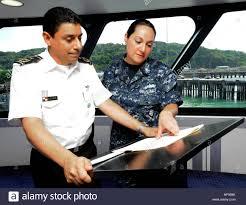 U S Navy Yeoman 1st Class Ursula Wilson Right Interprets
