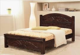 large bedroom furniture. Dark Brown Wooden Carving Bed Frame With Headboard And Beige Sheet On The Floor Large Bedroom Furniture G